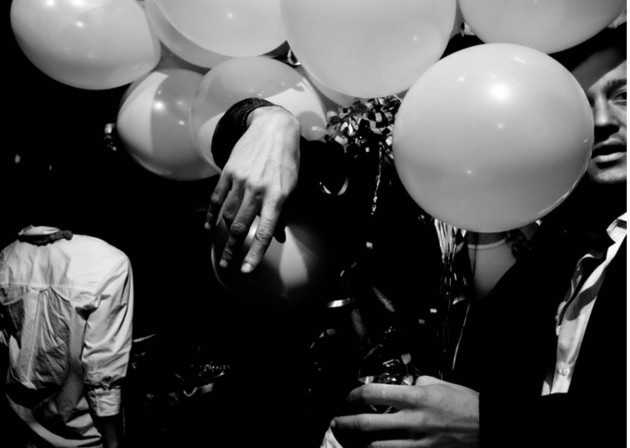 Man Covered By Balloons Black White