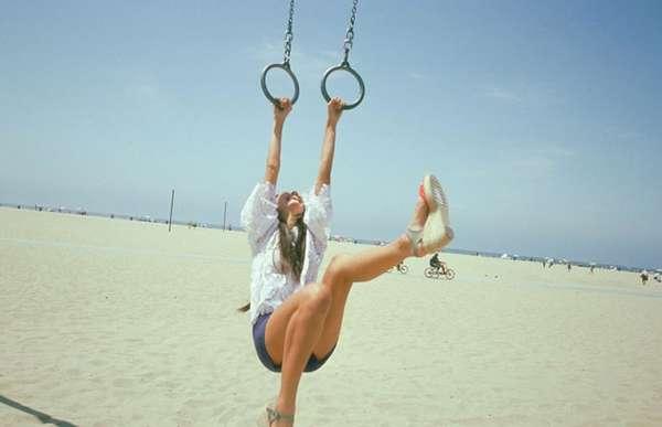 Woman Playing On Gymnastic Rings On Beach Darren Ankenman photo