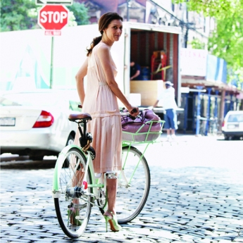 Sally Singer Riding Bike In Heels