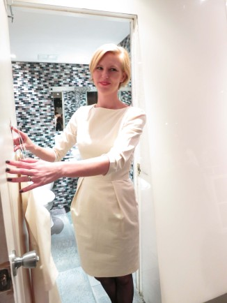 Shopper Trying On White Elsa And Me Dress Launch Party At Fika